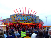 Crowds gather to waatch the opening of Hull fair on the Waltzer Steps